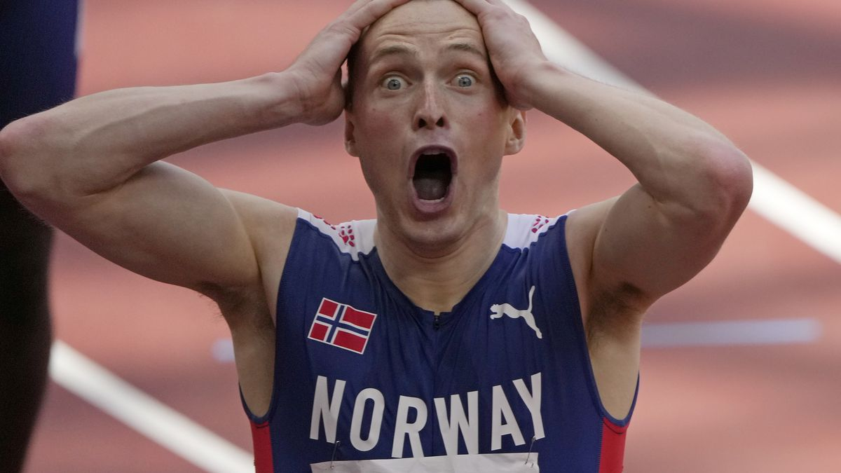 Karsten Warholm, of Norway celebrates as he wins the gold medal in the final of the men's 400-meter hurdles at the 2020 Summer Olympics