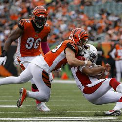 Arizona Cardinals quarterback Kyler Murray, right, is tackled on the run against Cincinnati Bengals outside linebacker Nick Vigil, left, in the second half of an NFL football game, Sunday, Oct. 6, 2019, in Cincinnati.