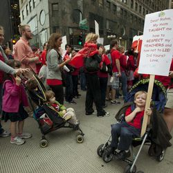 Children in strollers join thousands of public school teachers rallying outside the Hyatt Regency Hotel, protesting against Penny Pritzker, whom they accuse of benefiting from her position on the boards of both the Chicago Board of Education and Hyatt Hotels on Thursday, Sept. 13, 2012 in Chicago.