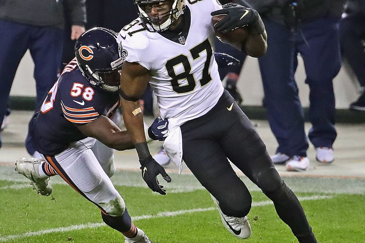 Jared Cook #87 of the New Orleans Saints breaks away from Roquan Smith #58 of the Chicago Bears after a catch at Soldier Field on November 01, 2020 in Chicago, Illinois. The Saints defeated the Bears 26-23 in overtime.