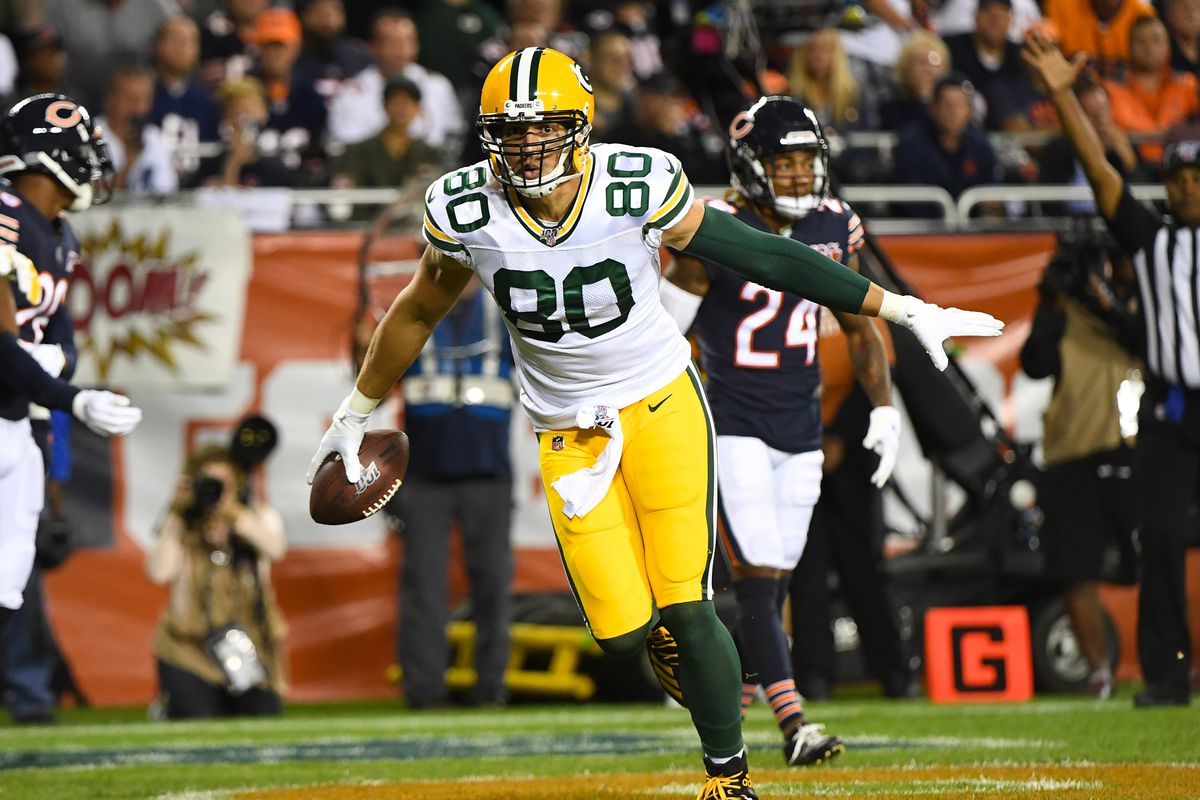 Green Bay Packers tight end Jimmy Graham celebrates after making a touchdown past in front of Chicago Bears defensive back Deon Bush during the second quarter at Soldier Field.