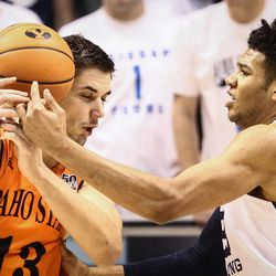 Brigham Young Cougars forward Yoeli Childs (23) fights with Idaho State Bengals center Novak Topalovic (13), causing him to lose control of the ball as BYU takes on Idaho State at the Marriott Center in Provo on Thursday, Dec. 21, 2017.