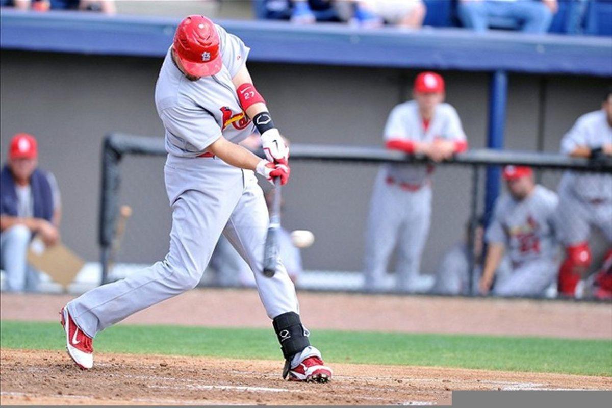 March 12, 2012; Melbourne, FL, USA;   St. Louis Cardinals second baseman Tyler Greene (27) hits the ball during the spring training game against the Washington Nationals at Space Coast Stadium. Mandatory Credit: Brad Barr-US PRESSWIRE