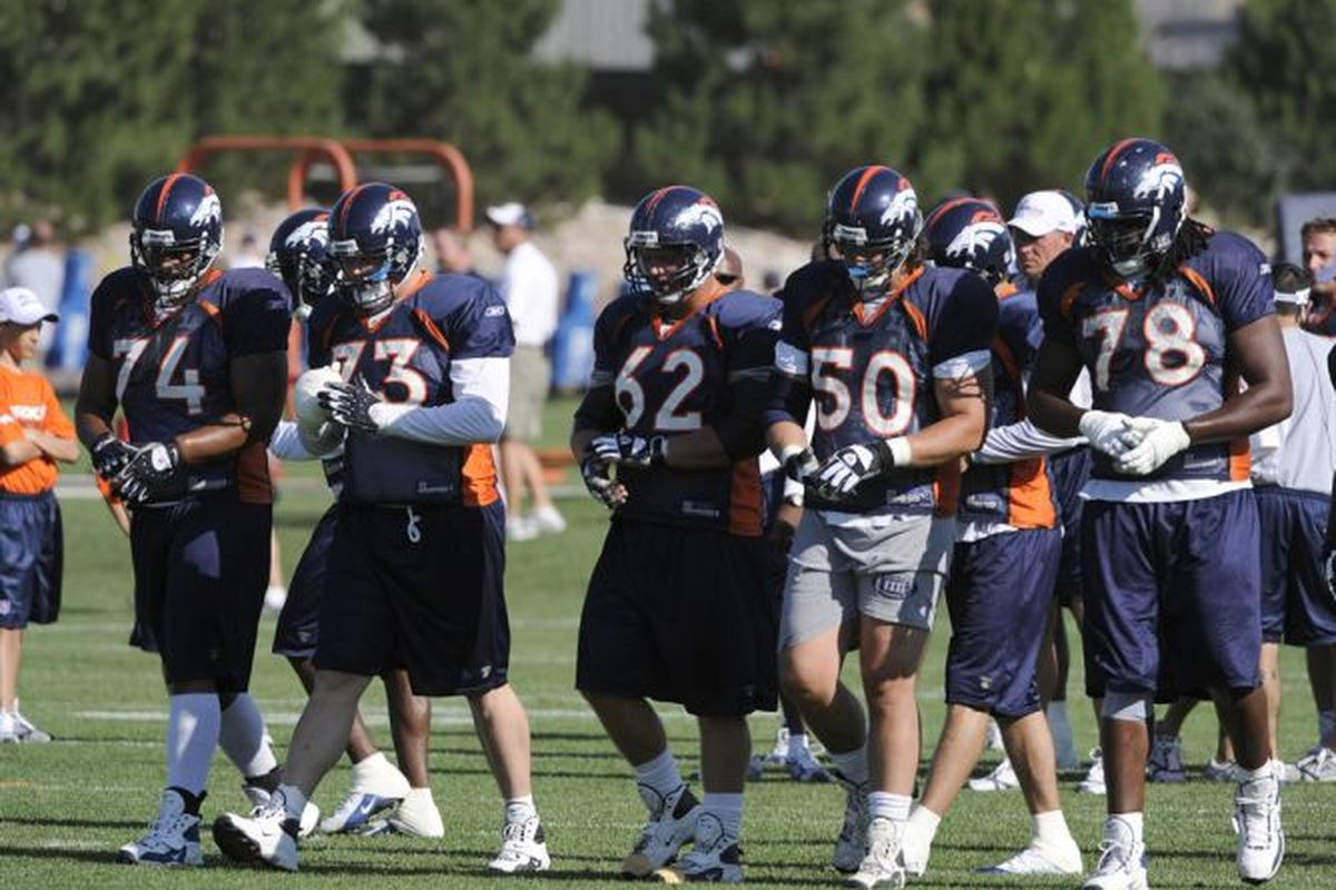 Denver Broncos offensive linemen take part in drills during the team's football minicamp at the Broncos headquarters in Englewood, Colo., on Sunday, June 14, 2009. (AP Photo/David Zalubowski)