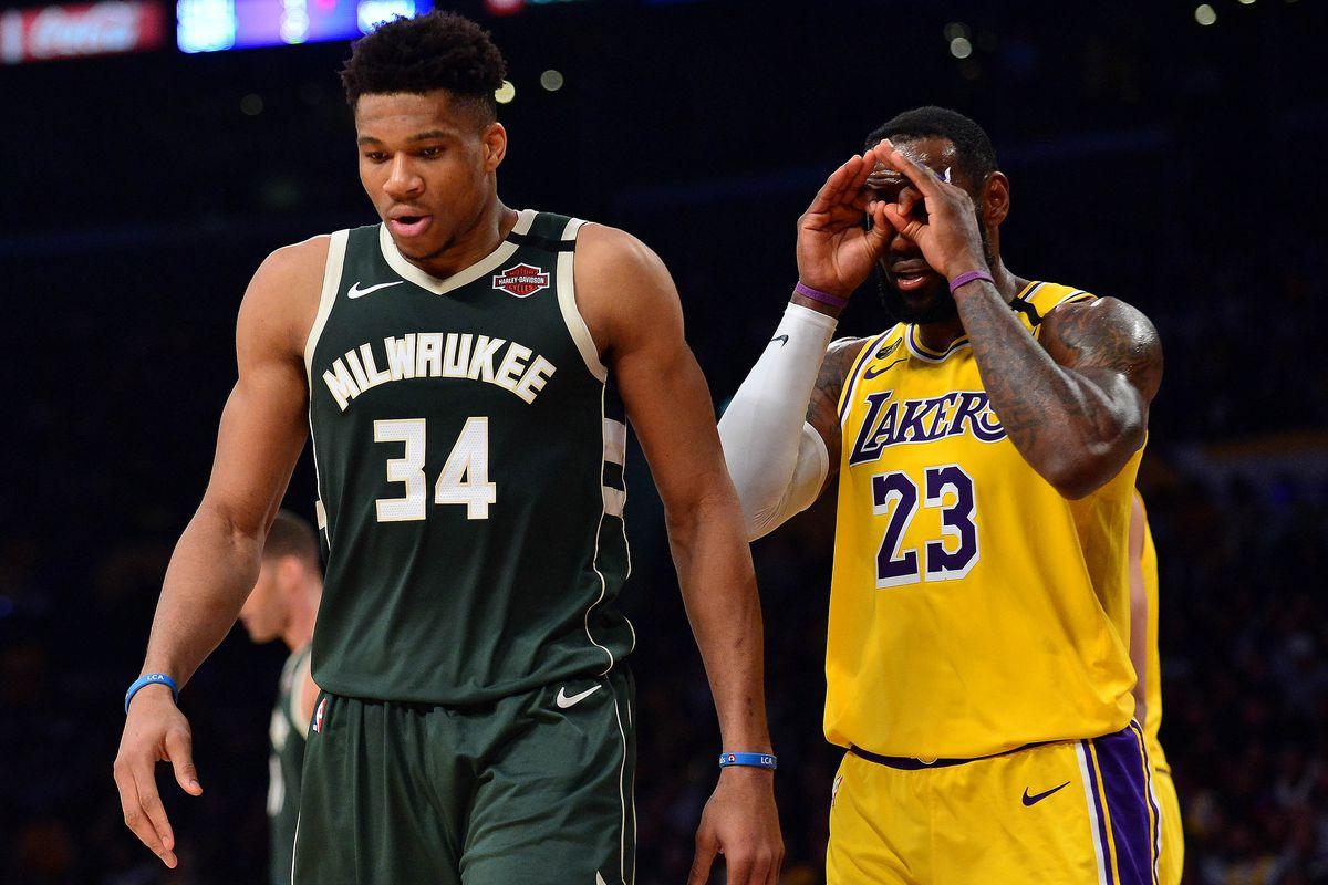 Los Angeles Lakers forward LeBron James reacts toward Milwaukee Bucks forward Giannis Antetokounmpo during the second half at Staples Center.
