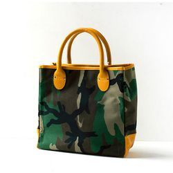 """<b>Bags in Progress</b> Tool Tote, <a href=""""https://frenchgarmentcleaners.com/catalog/womens/products/s13-tool-tote-camo-2"""">$297</a> at French Garment Cleaners"""