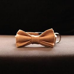 """Stella bow tie, <a href=""""http://www.max-bone.com/collections/collars-leashes/products/bow-tie-stella""""target=""""_blank"""">$45</a>"""