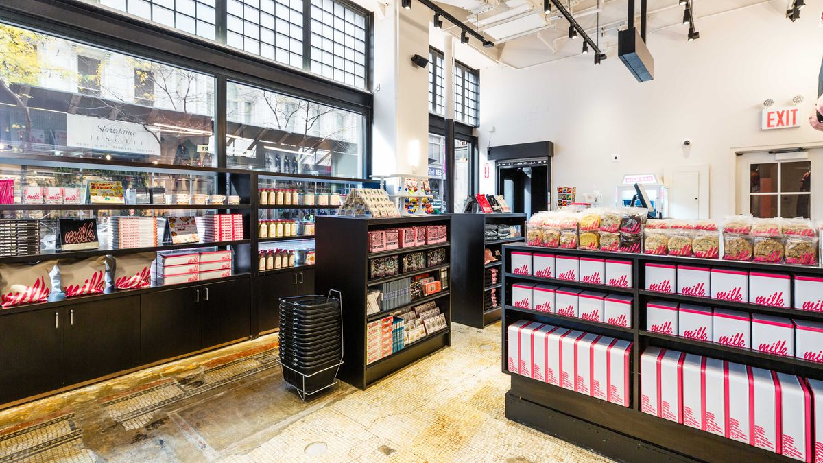 Packaged goods and merchandise sit near large windows at the new Milk Bar