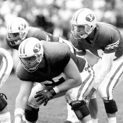BYU's Garry Pay prepares to deliver a snap to Ty Detmer during their playing days in Provo. His son Connor is offensive lineman on this year's Cougars.