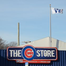 10:03 a.m. W flag being flown over the Cubs Store, across from the ballpark -