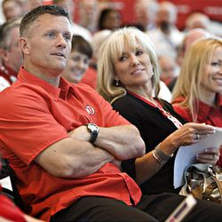 University of Utah head football coach Kyle Whittingham is present at a press conference that announced the university's acceptance of the invitation to join the Pac-10 Athletic Conference at Rice-Eccles Stadium in Salt Lake City Thursday.