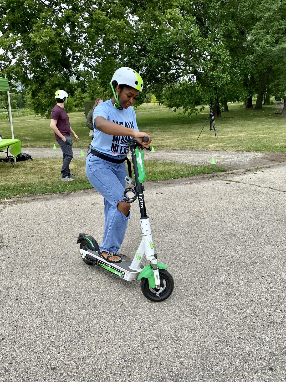 Chloe Graham, program coordinator for My Block My Hood My City, tests out the scooters that will be using in upcoming neighborhood tours.