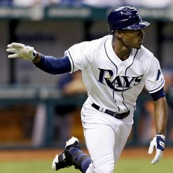Tampa Bay Rays' B.J. Upton flips his bat after hitting a fifth-inning home run off New York Yankees starting pitcher Freddy Garcia during a baseball game, Tuesday, Sept. 4, 2012, in St. Petersburg, Fla.