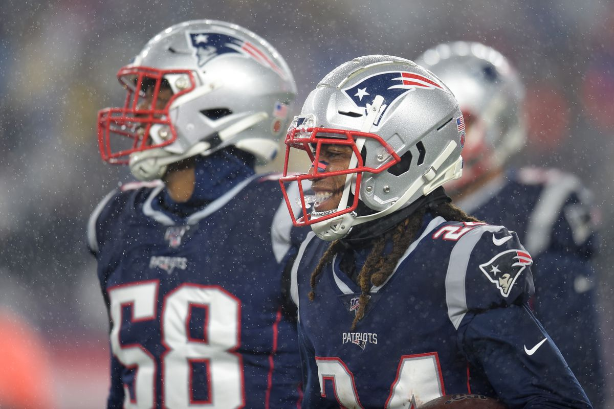 New England Patriots cornerback Stephon Gilmore heads to the bench after making an interception during the first half against the Dallas Cowboys at Gillette Stadium