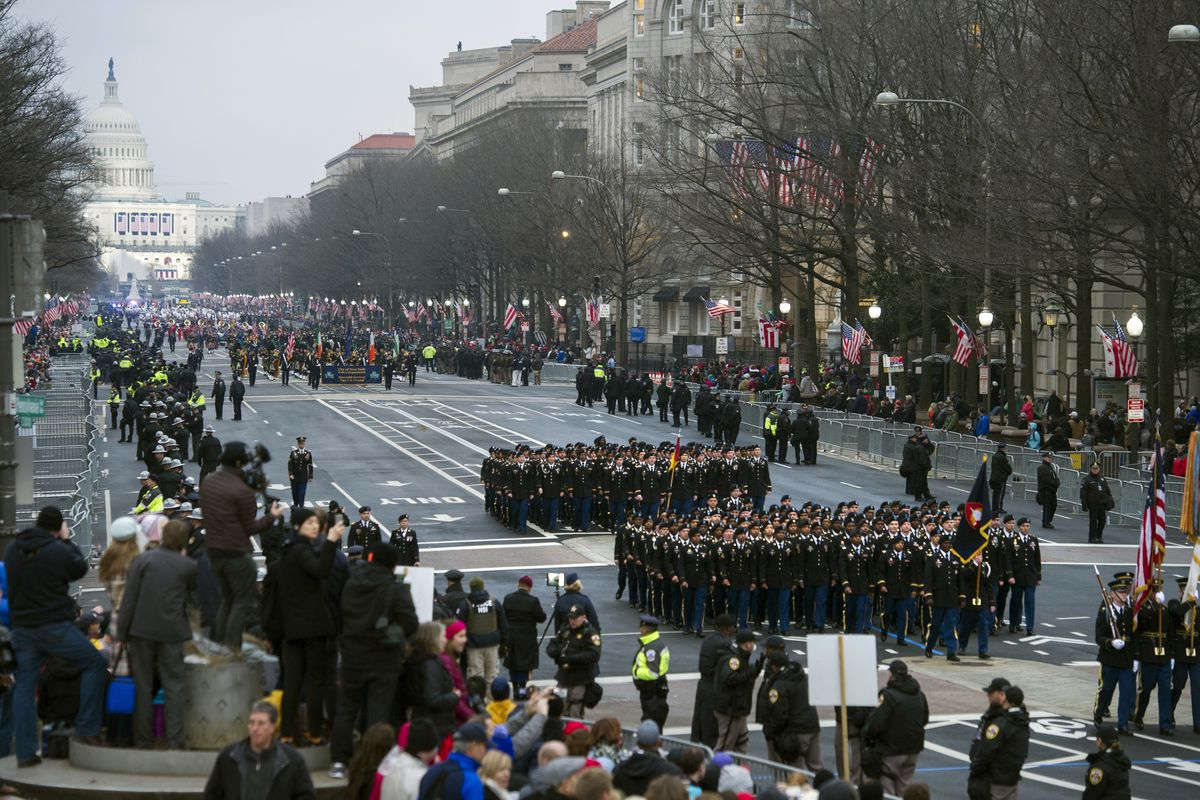 FILE - In this Jan. 20, 2017, file photo, military units participate in the inaugural parade from the Capitol to the White House in Washington, Friday, Jan. 20, 2017. A U.S. official says the 2018 Veterans Day military parade ordered up by President Donal