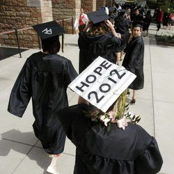 Students make their way into the Tabernacle on Temple Square as they take part in LDS Business College's 125th Commencement exercise Friday, April 13, 2012.