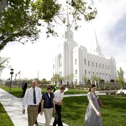 The Graff family from Layton Utah walk past the temple after the Cornerstone ceremony. About 200 took part in the ceremony at the Brigham City Temple prior to the dedication Sunday, Sept. 23, 2012.