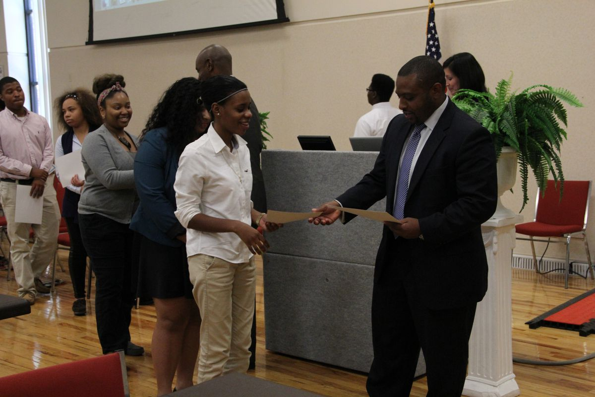 Memphis students receive congratulations Thursday from Shelby County Schools board member Kevin Woods after earning an IT certification following a summer learning program.