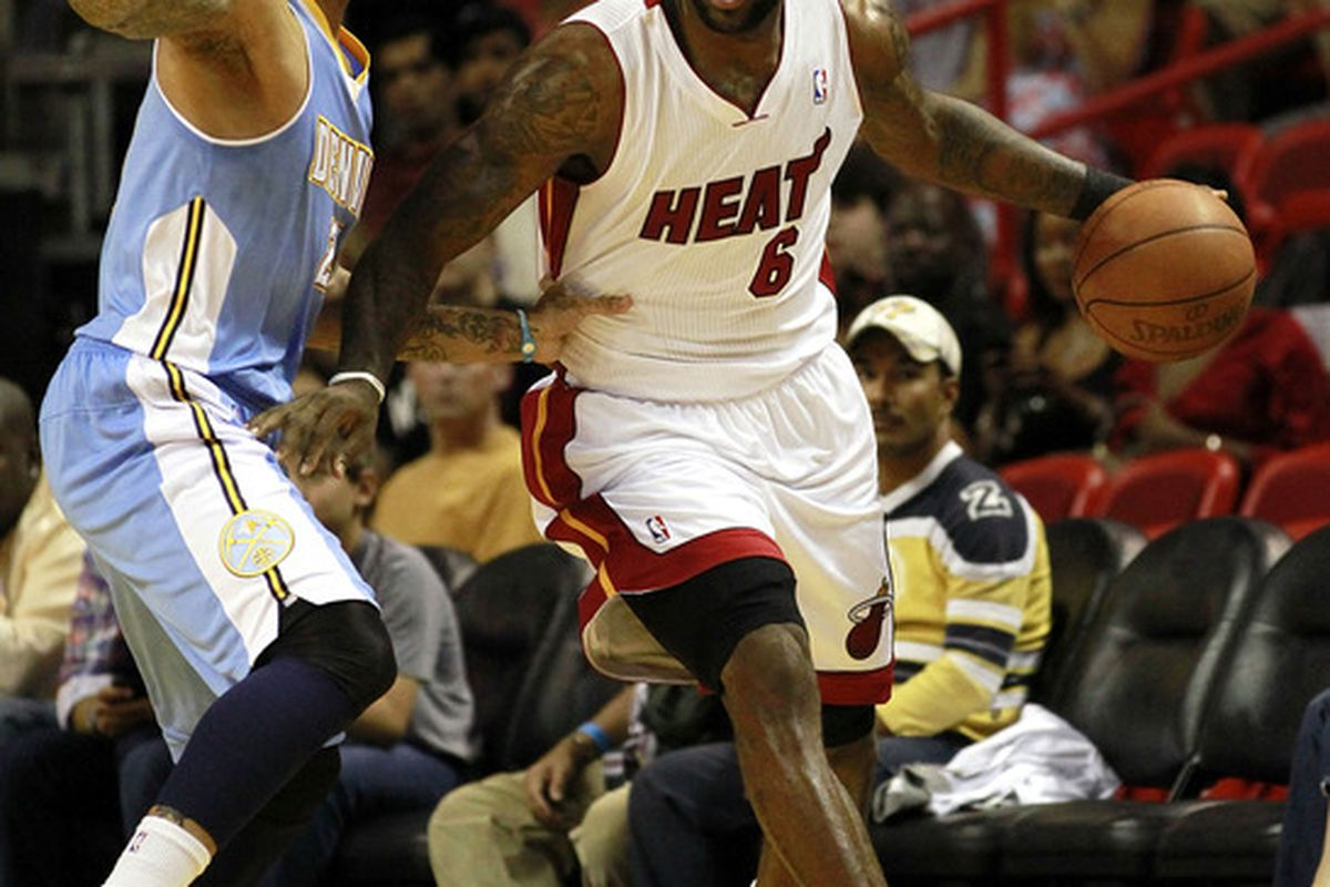 MIAMI, FL - MARCH 19:  Forward LeBron James #6 of the Miami Heat drives against Forward Wilson Chandler #21 of the Denver Nuggets at American Airlines Arena on March 19, 2011 in Miami, Florida.<em> (Photo by Marc Serota/Getty Images)</em>