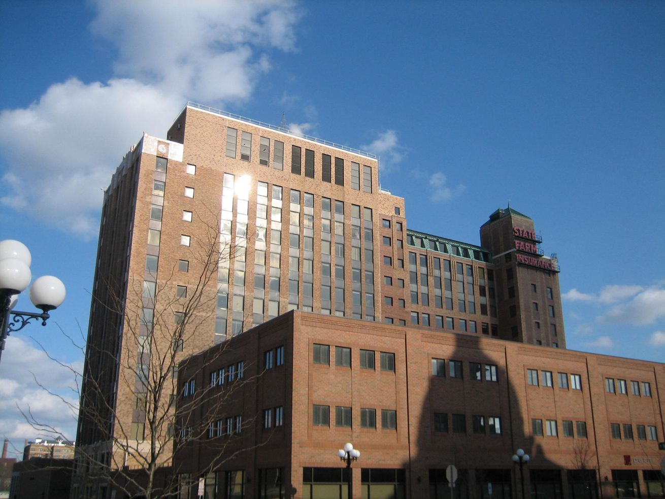 The State Farm insurance building, a brown Art Deco structure, in Bloomington, Indiana.