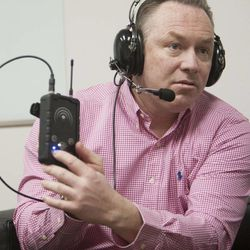 Todd Rapier and other officials at Multi-Voice in Provo talk Tuesday, Jan. 13, 2015, about a new technology that allows multiple users to communicate via walkie-talkie.