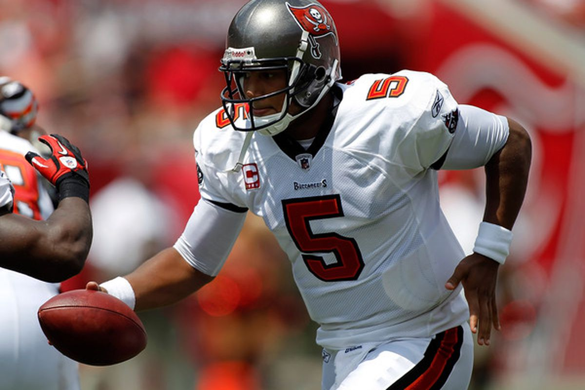 TAMPA FL - SEPTEMBER 12:  Quarterback Josh Freeman #5 of the Tampa Bay Buccaneers hands the ball off against the Cleveland Browns during the game at Raymond James Stadium on September 12 2010 in Tampa Florida.  (Photo by J. Meric/Getty Images)