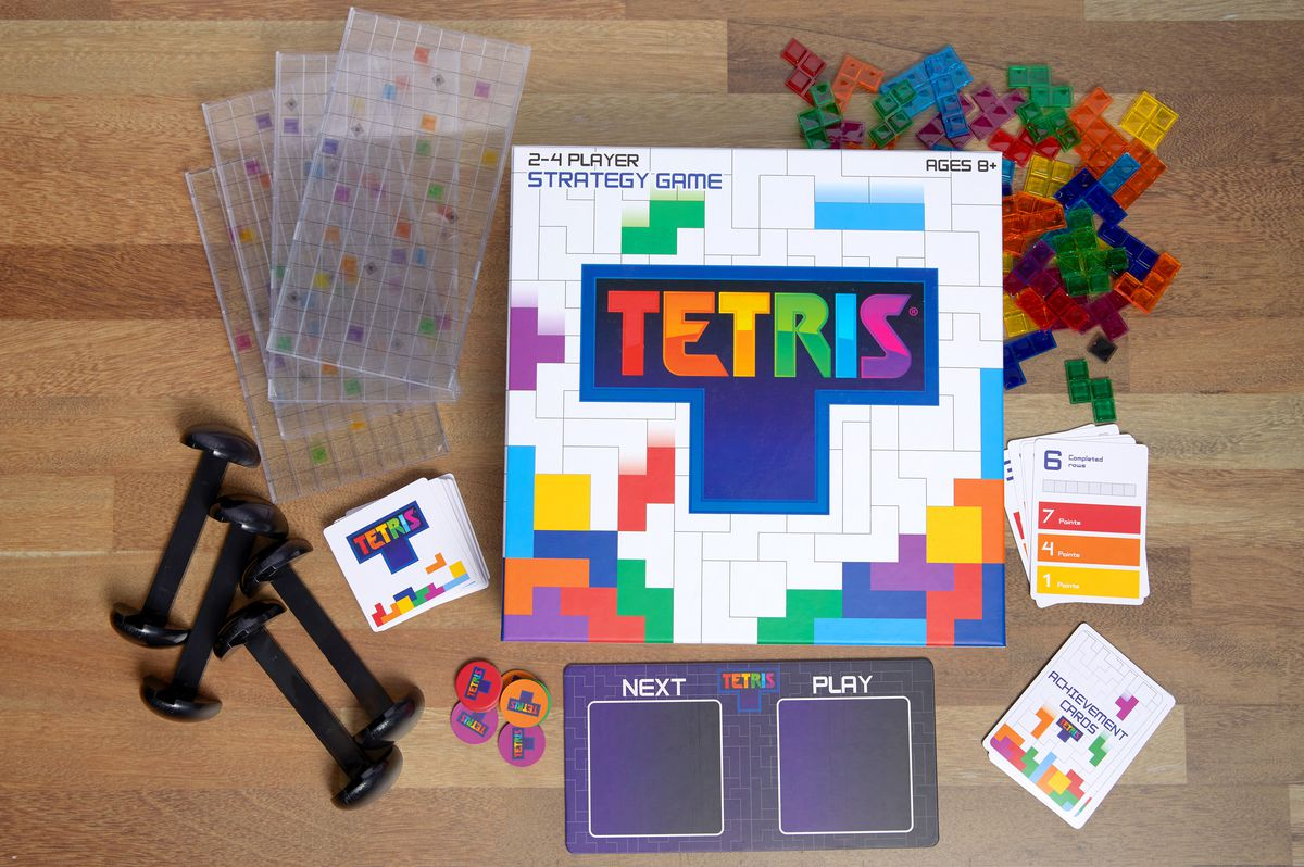 The contents of the Tetris strategy board game laid out on the table.