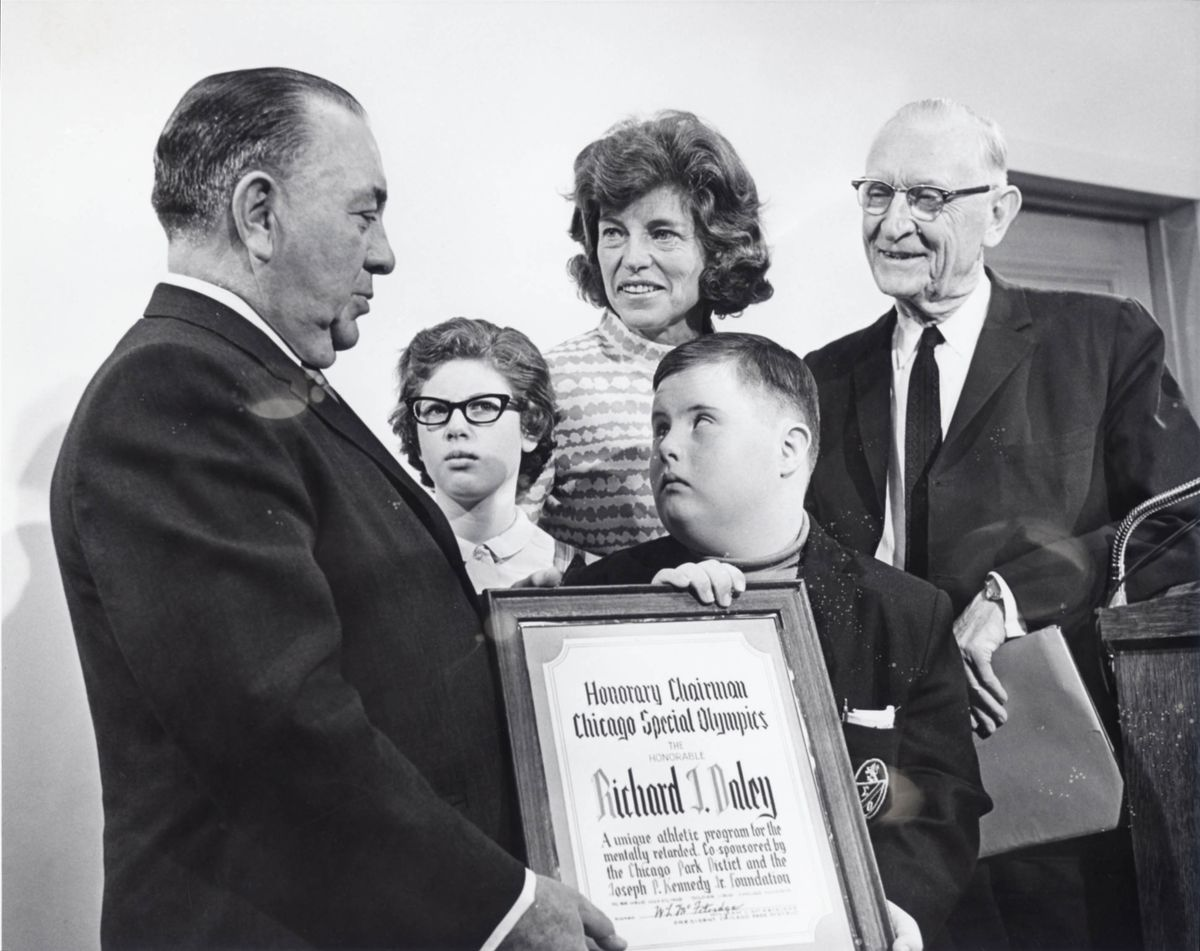 Eunice Kennedy Shriver, center, WilliamMcFetridgeof theChicago Park District,right,and Special Olympics athletes, including Kevin O'Brien,meet with Chicago Mayor Richard J. Daley, left, before the 1968ChicagoSpecial Olympics Games.   Special Olymp