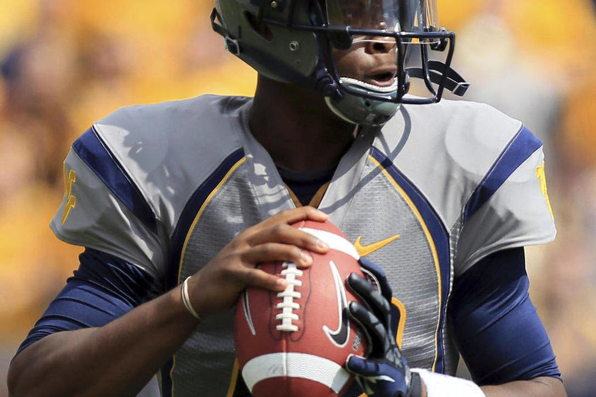 West Virginia quaterback Geno Smith (12) looks for a receiver during the first half of an NCAA college football game against Maryland in Morgantown, W.Va., Saturday, Sept. 22, 2012.
