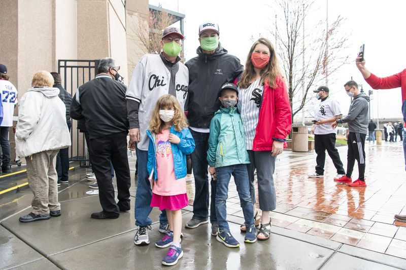 The May family waits in line to enter Guaranteed Rate Field for the Chicago White Sox home opener, Thursday, April 8, 2021.