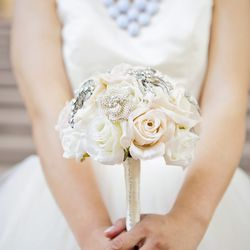 """The broche bouquet is from Etsy. """"I wanted something that I could save from today."""""""