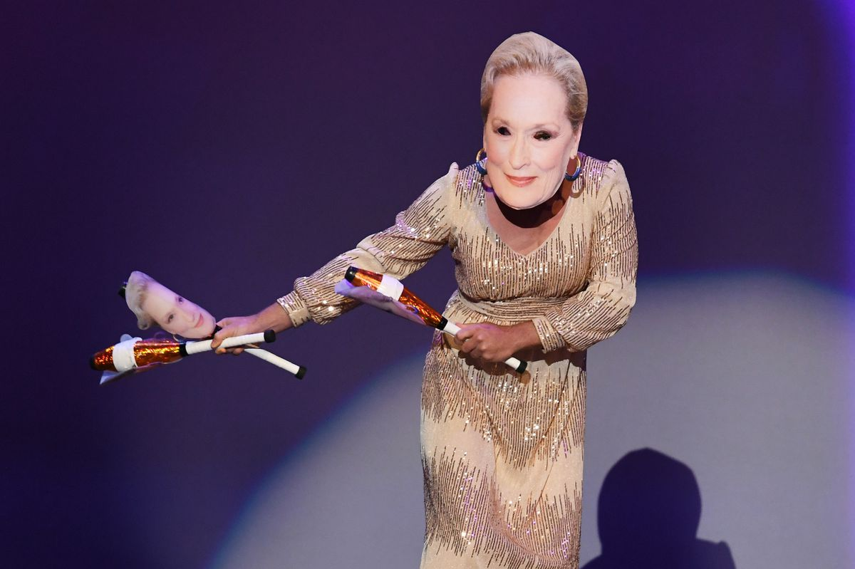 juggler with meryl streep mask dances across the emmy stage