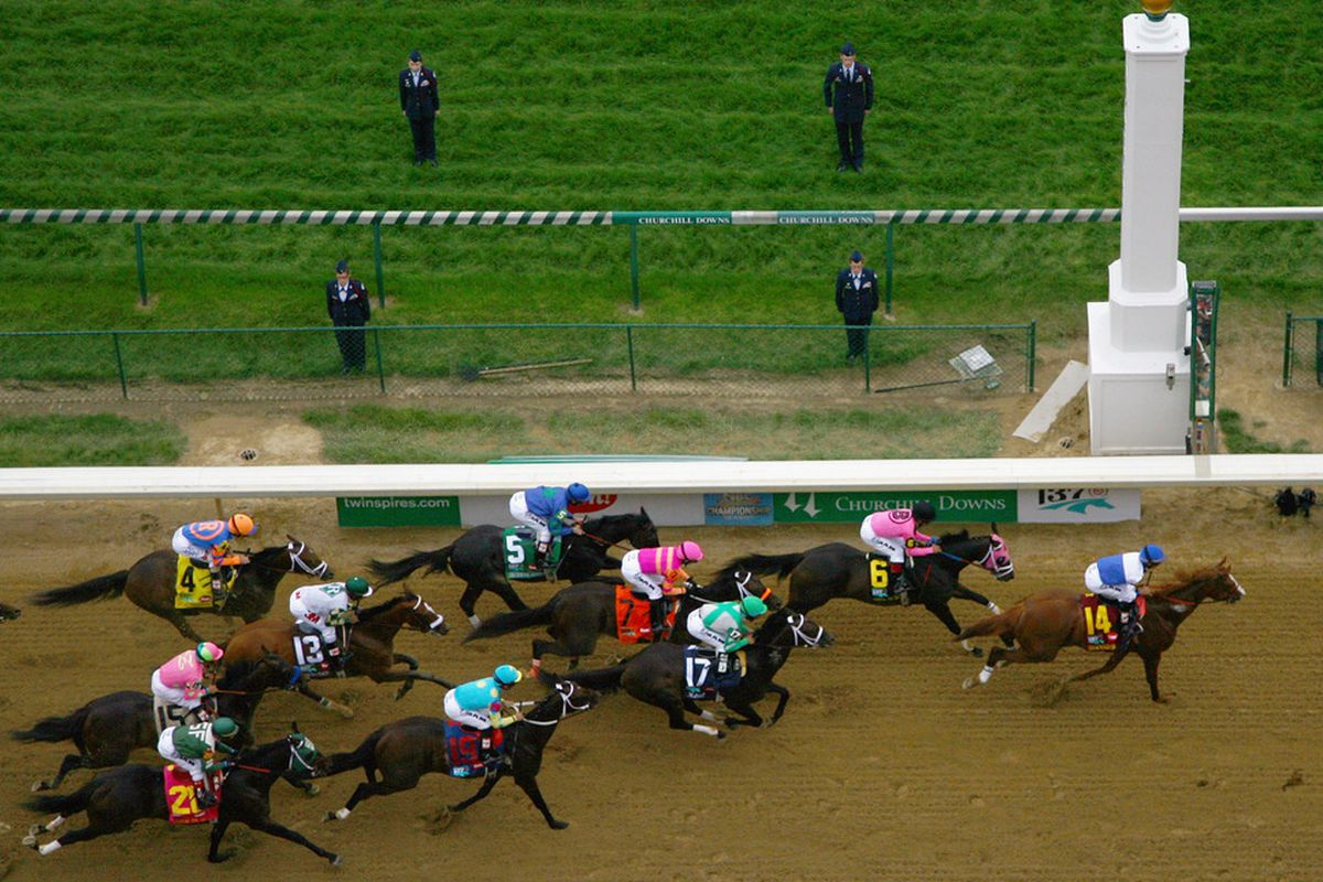 LOUISVILLE, KY - The pack of horses races past the finish line during the 137th Kentucky Derby at Churchill Downs in Louisville, Kentucky.  (Photo by Jamie Squire/Getty Images)