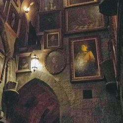 """Talking portraits line a hallway at the """"Harry Potter and the Forbidden Journey"""" 4-D ride"""