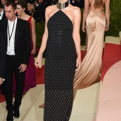 Olivia Wilde wears a Micheal Kors gown.