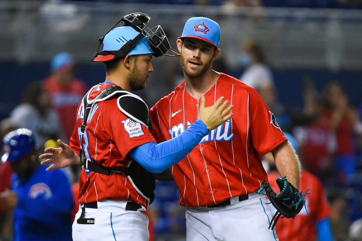 Anthony Bender #80 of the Miami Marlins celebrates with Alex Jackson #23 after defeating the against the Chicago Cubs at loanDepot park
