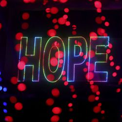 """Lights spell """"Hope"""" on the side of Rio Tinto Stadium in Sandy during """"Light the RioT,"""" a drive-thru light show, on Monday, May 4, 2020."""