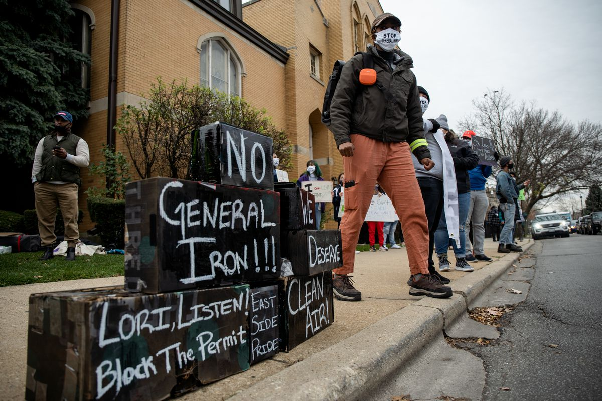 A protester attends a rally near Mayor Lori Lightfoot's Logan Square home Saturday urging her administration to deny the final permit that will allow General Iron to move from Lincoln Park, a mostly white neighborhood, to the Southeast Side, which has a mostly Latino population.