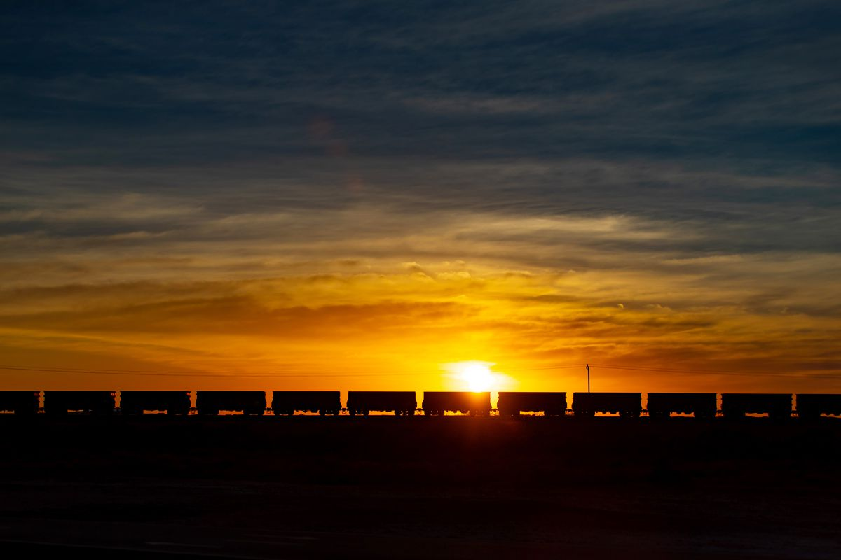 Wagons Of Iron Ore Make Their Way To Port By Rail And Road