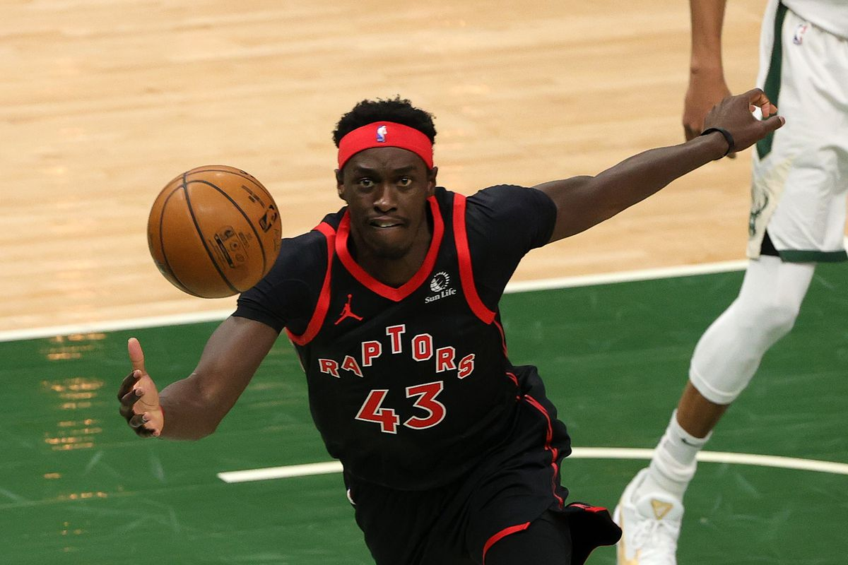 Pascal Siakam of the Toronto Raptors reaches for a loose ball during the first half of a game against the Milwaukee Bucks at Fiserv Forum on February 16, 2021 in Milwaukee, Wisconsin.