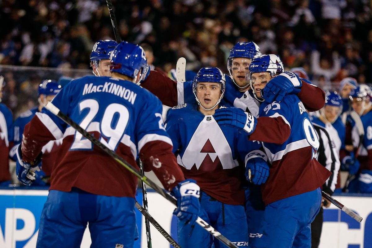 Colorado Avalanche defenseman Samuel Girard celebrates with left wing Andre Burakovsky and defenseman Erik Johnson and right wing Mikko Rantanen and center Nathan MacKinnon after his goal in the second period against the Los Angeles Kings during a Stadium Series hockey game at U.S. Air Force Academy Falcon Stadium.