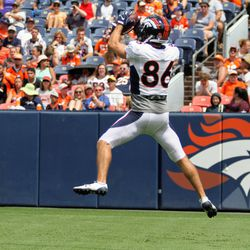 Nick Williams, Broncos WR, goes up and snatches a pass during practice at Broncos Stadium at Mile High.