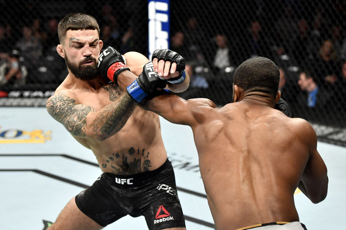 Geoff Neal punches Mike Perry in their welterweight bout during the UFC 245 event at T-Mobile Arena on December 14, 2019 in Las Vegas, Nevada.