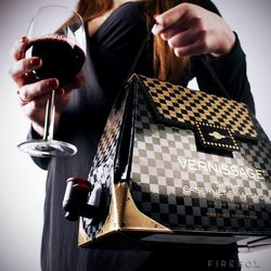 "Wine and Design wine handbags, <a href=""http://www.firebox.com/product/5868/Wine-Handbags"">Firebox</a>, $45."
