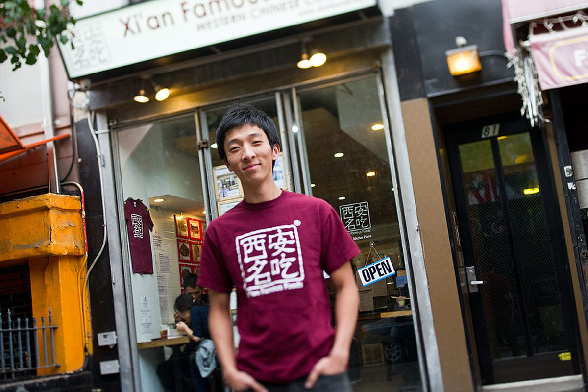 [Jason Wang in front of Xi'an Famous Foods in the East Village]