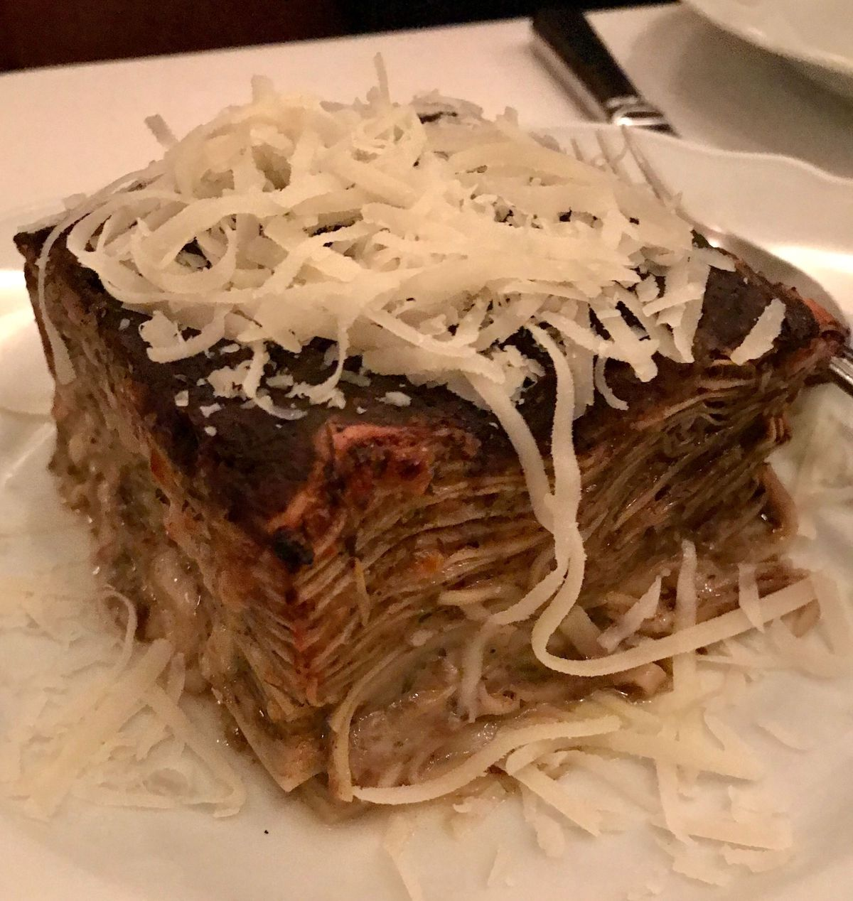 Multi-layered lasagna topped with cheese