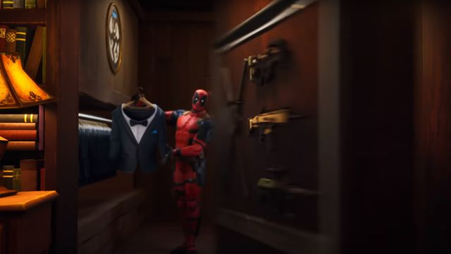 Deadpool making a brief appearance behind a trick bookshelf in the Fortnite chapter 2 season 2 launch trailer