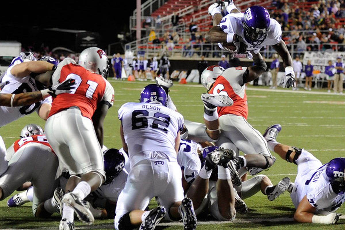 Ed Wesley (airborne) and Jeff Olson (62) are sure bets for TCU's offense in 2011.