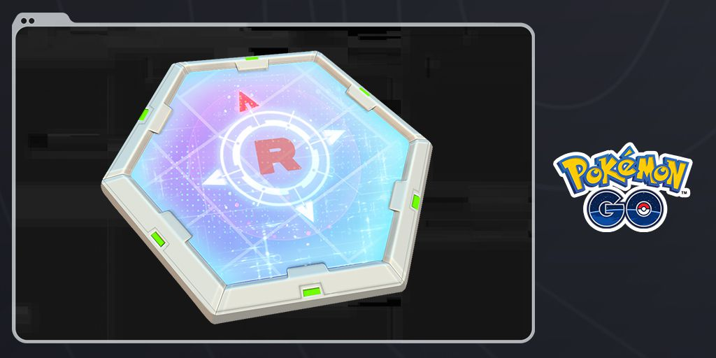 A hexagonal piece of technology with a Team Rocket logo in the center
