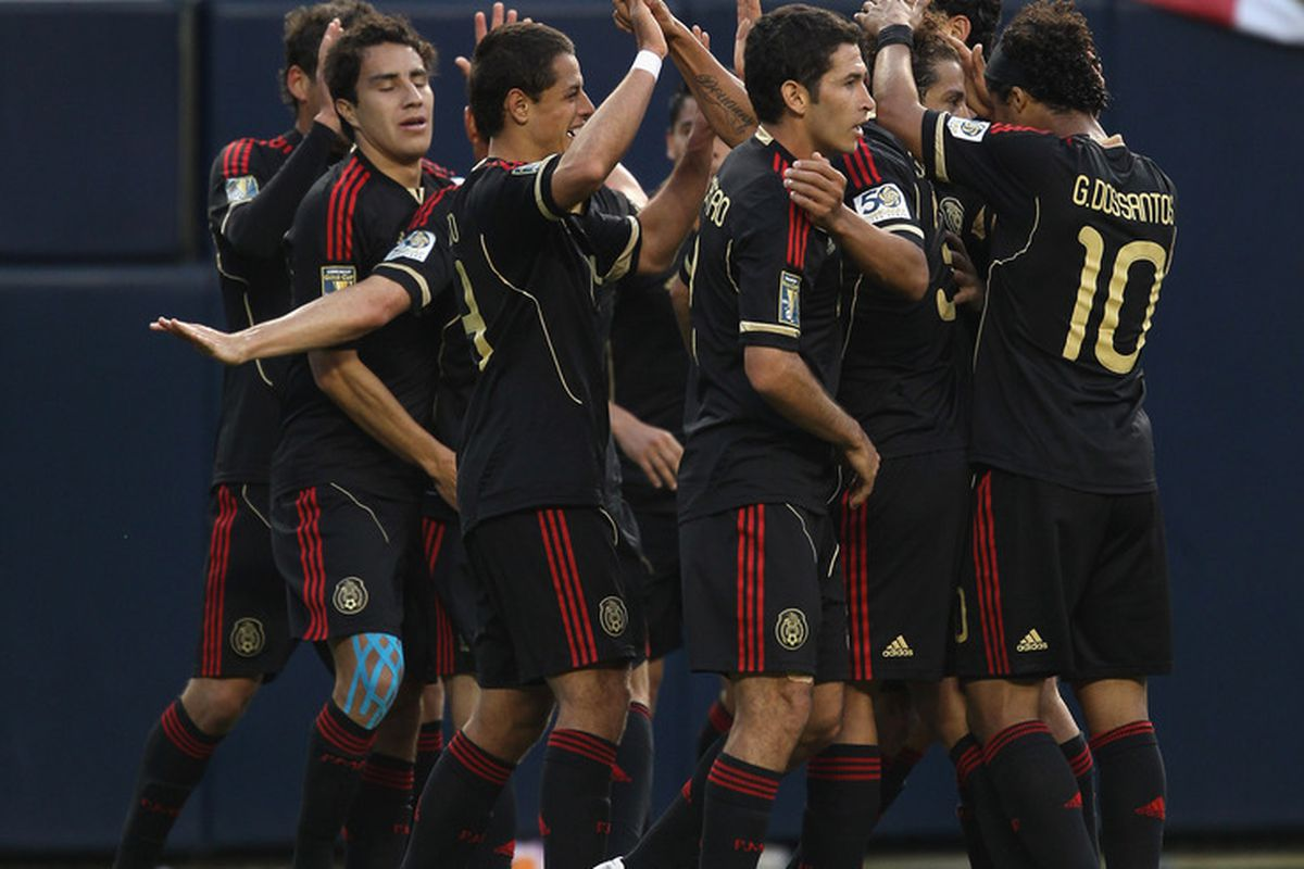 CHICAGO, IL - JUNE 12:  Members of Mexico celebrate a goal against Costa Rica during a CONCACAF Gold Cup 2011 match at Soldier Field on June 12, 2011 in Chicago, Illinois. Mexico defeated Costa Rica 4-1.  (Photo by Jonathan Daniel/Getty Images)